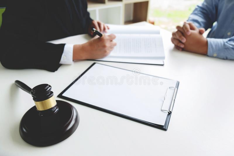 Judge gavel with legal documents, lawyer consulting with business man.  royalty free stock photography