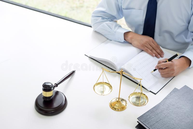 Judge gavel with scales of justice, male lawyers working having royalty free stock images