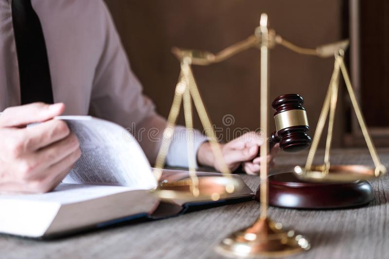 Judge gavel with scales of justice, male lawyers working having at law firm in office. Concepts of law advice and justice stock images