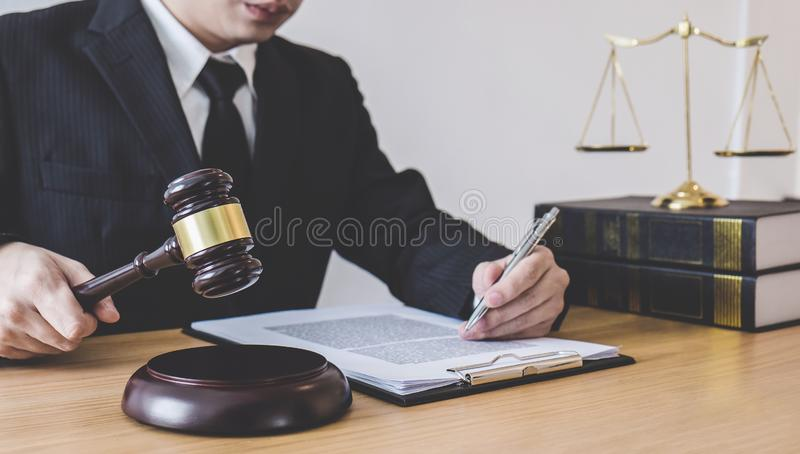 Judge gavel with scales of justice, professional male lawyers or counselor working having at law firm in office. Concepts of law.  stock images