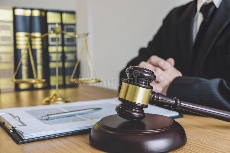 Judge gavel with scales of justice, professional male lawyers or counselor working having at law firm in office. Concepts of law.  stock photos
