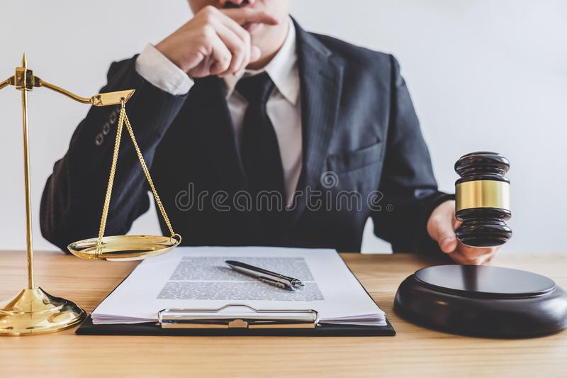 Judge gavel with scales of justice, professional male lawyers or royalty free stock image