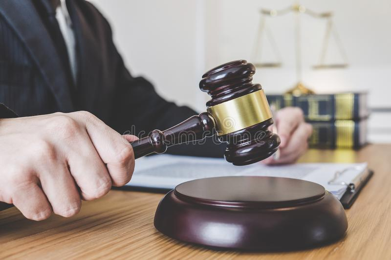 Judge gavel with scales of justice, professional male lawyers or. Counselor working having at law firm in office. Concepts of law stock images