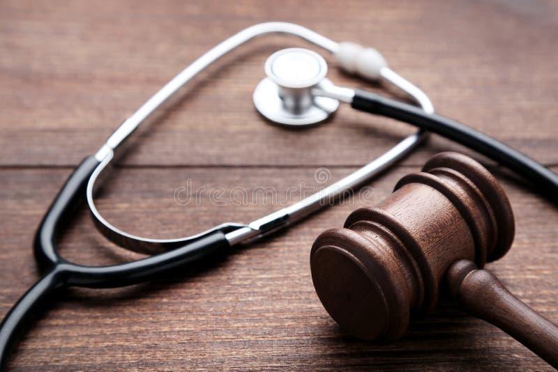 Judge gavel with stethoscope stock photo