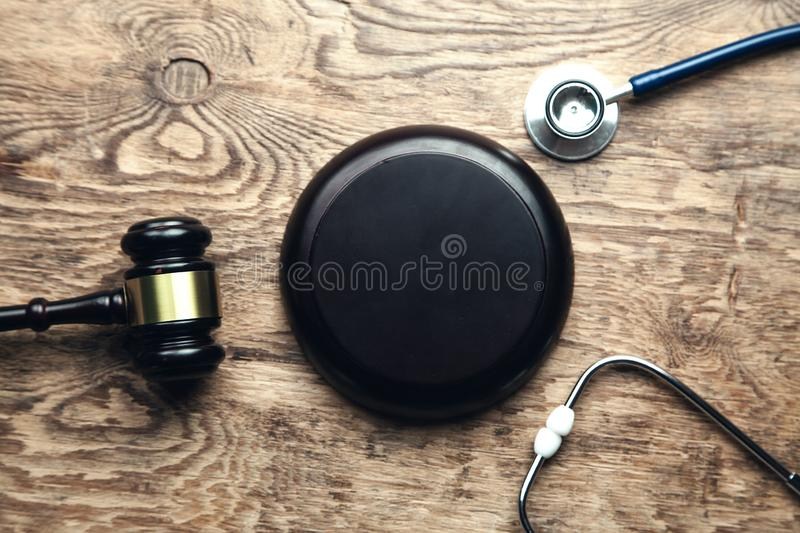 Judge gavel with stethoscope. Medical law royalty free stock photo