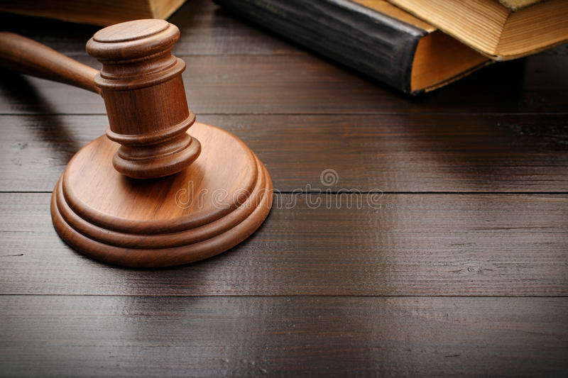 Judge hammer with old legal book royalty free stock image