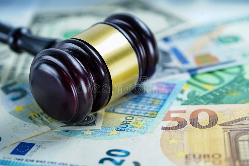 Judge hammer on US dollar and Euro banknotes stock images