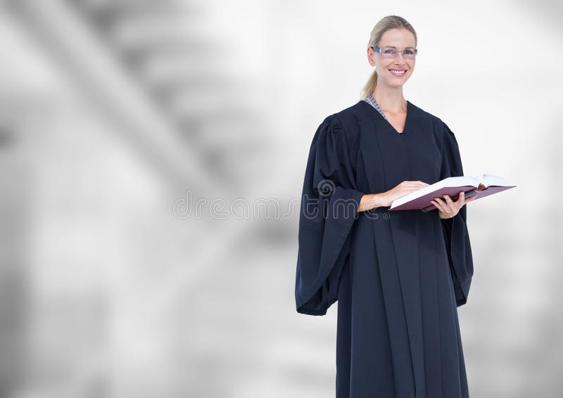 Judge holding book in front of bright staircase royalty free stock photos