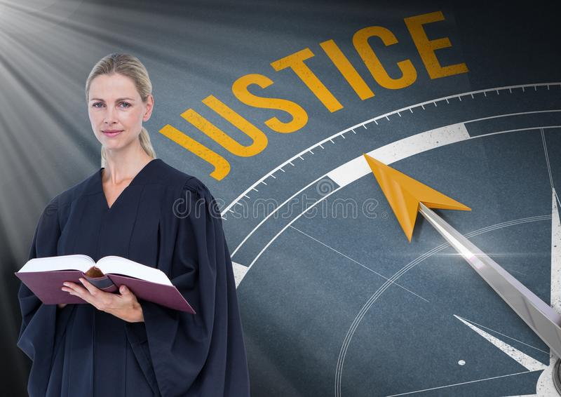 Judge holding book in front of justice text and compass stock images