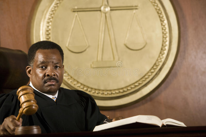 Judge Holding Gavel stock images