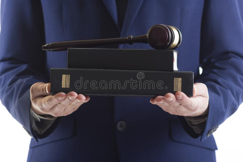 Judge holding gavel and book. Law and justice concept. royalty free stock image