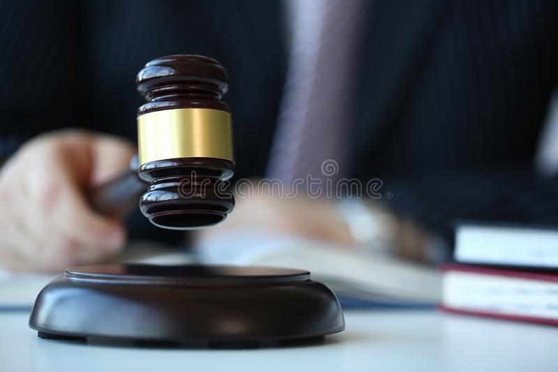 Judge holding hammer in hand lies. On table in debate room for fair judgments economic notions of violations legal system fraud and punishment royalty free stock images