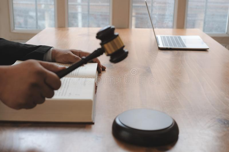 judge holding legal law gavel with book at courtroom. lawyer attorney justice royalty free stock photos