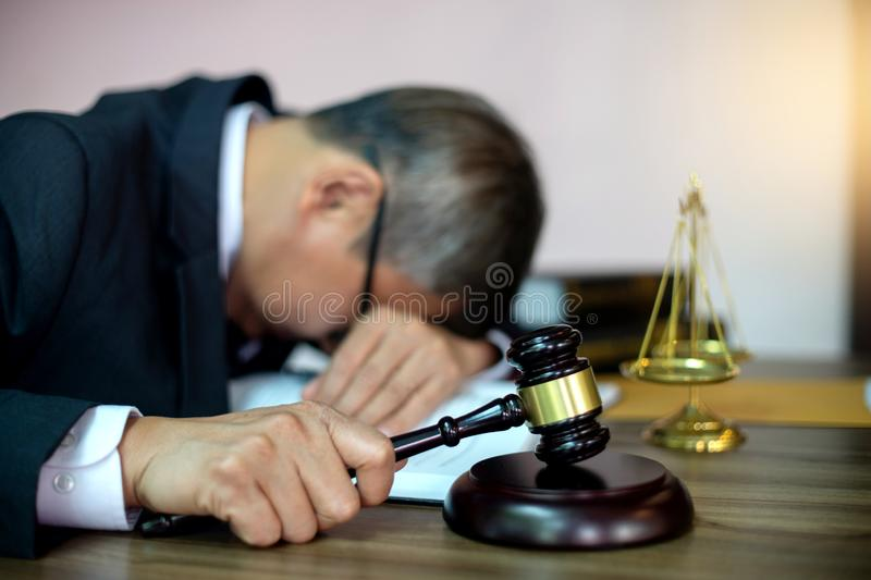Judge lawyer gavel tired and sleeping in office stock images