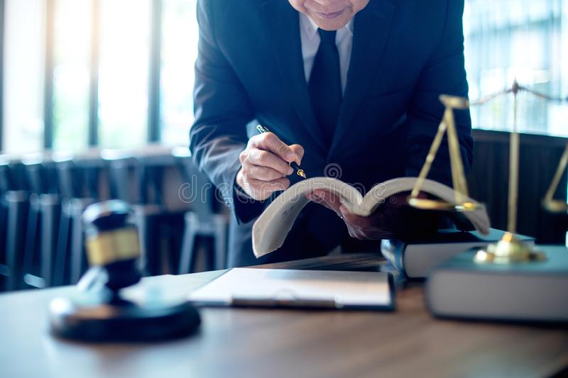 Judge lawyer gavel work in office with balance. In law firm concept royalty free stock photography