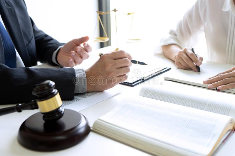 Judge or lawyer talking  with team. Or client about consult law detail, law firm concept, legal, justice, attorney, background, meeting, contract, business stock photo