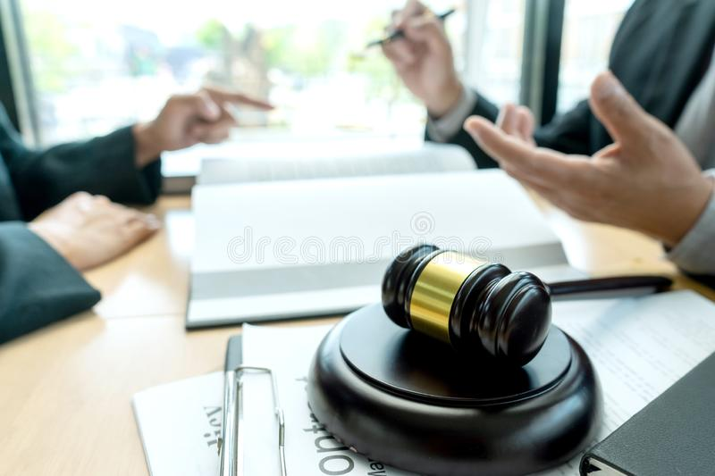 Judge or lawyer talking  with team. Or client about consult law detail, law firm concept, legal, justice, attorney, background, meeting, contract, business stock images