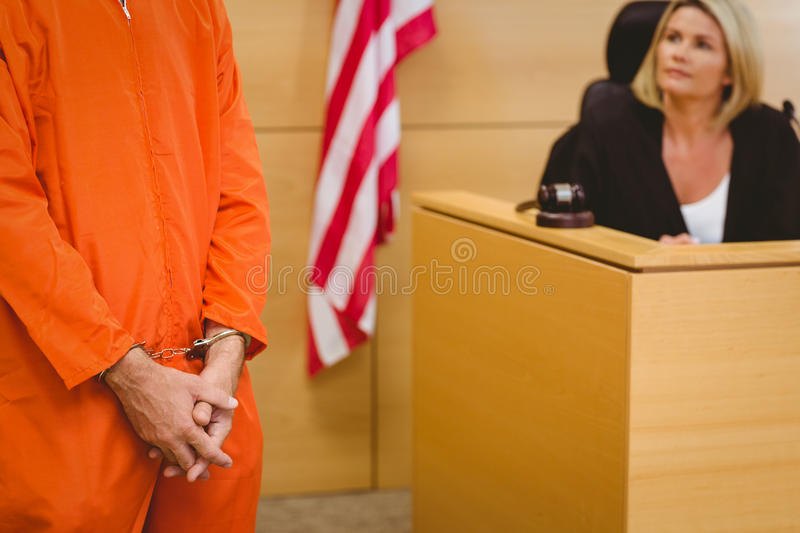 Judge looking the condemned prisoner. In the court room stock photography