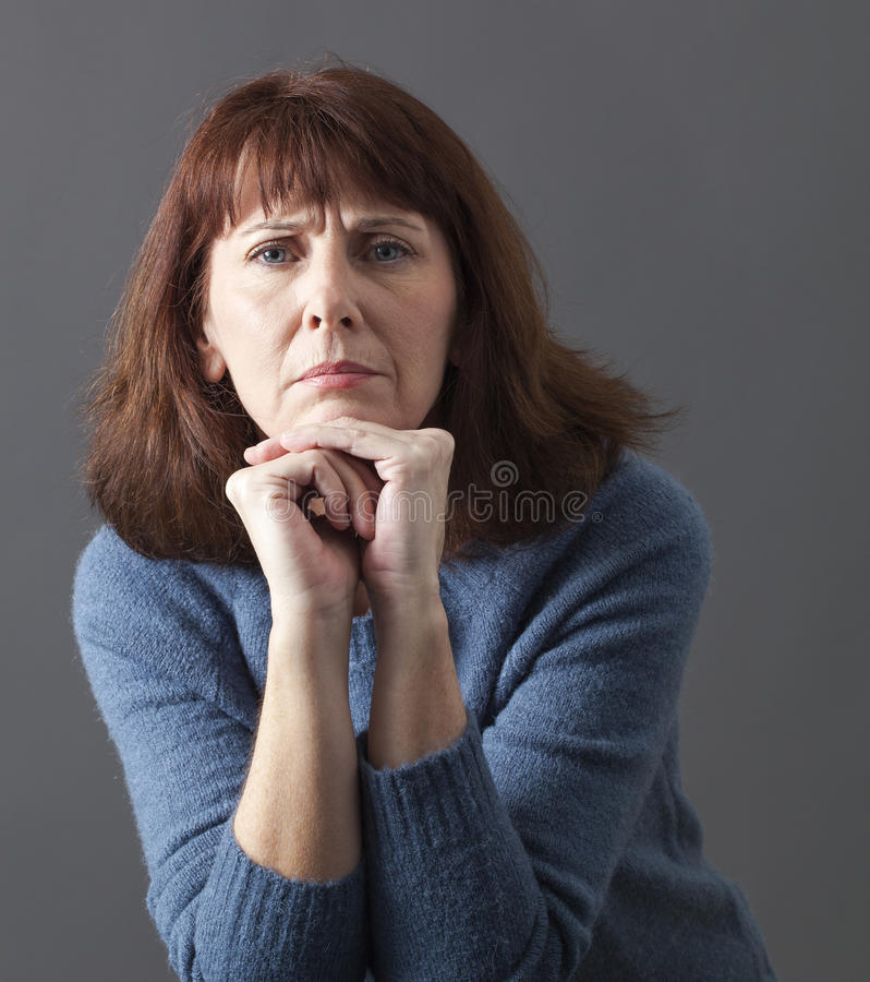 Judge mental concept for exasperated 50s woman. Judge mental concept - exasperated 50s woman expressing disagreement and blame with silent hand gesture,studio stock photography