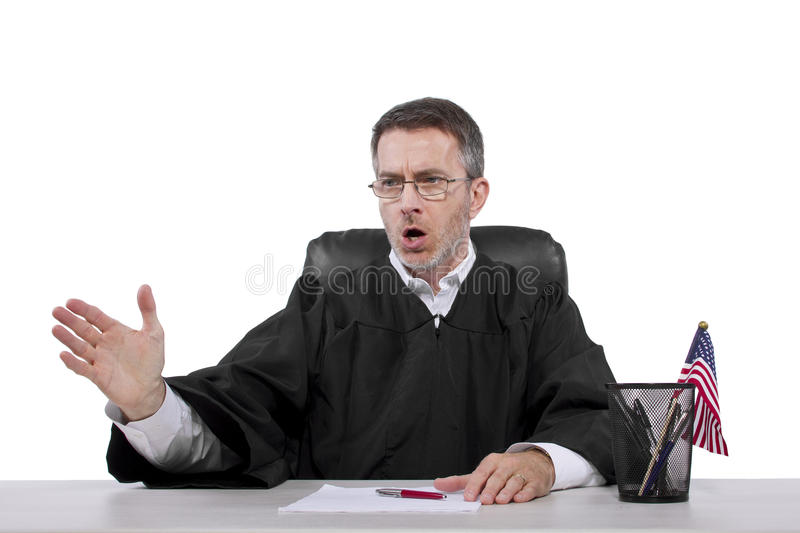 Judge. Middle aged caucasian american judge in a robe sitting royalty free stock photos