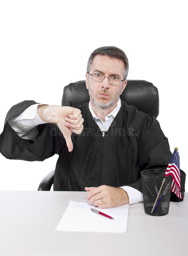 Judge. Middle aged caucasian american judge in a robe sitting royalty free stock image