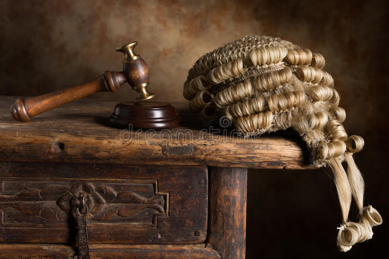 Court wig and hammer. Judge's court wig and hammer or gavel royalty free stock photo