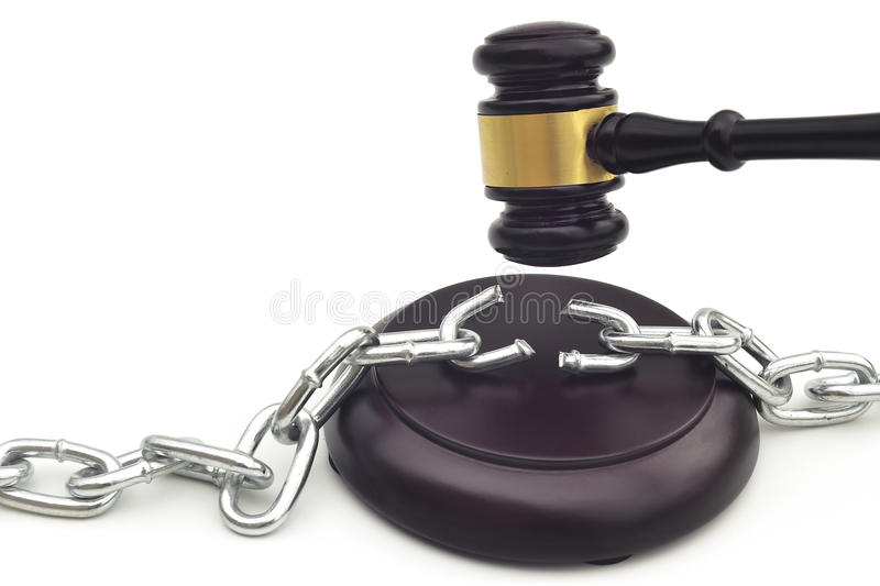 JUDGE'S DECISION FOR SETTING FREE. A gavel brakes the chains ordering to set free stock image