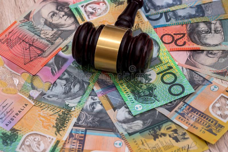 Judge`s gavel on australian dollars, justice concept.  stock photo