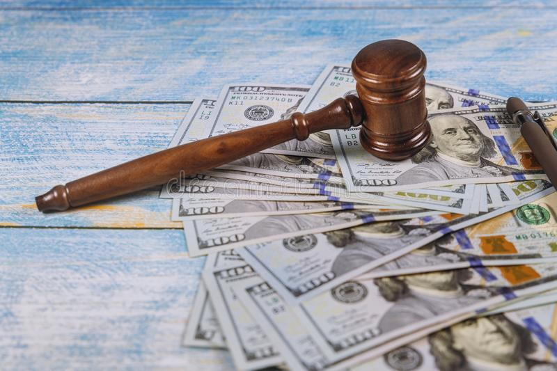 The judge& x27;s gavel, banknotes of American dollars on the business, finance corruption money financial crime. The judge& x27;s gavel, banknotes of American royalty free stock image
