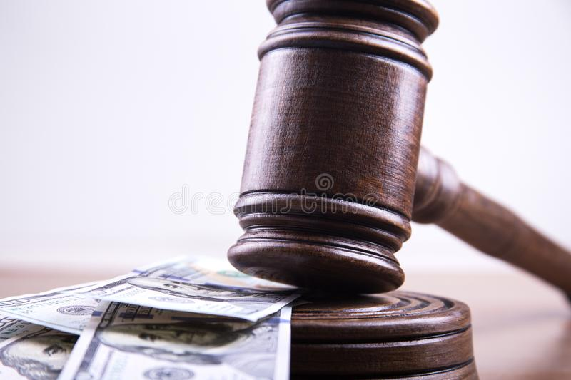Judge`s gavel, bills of american dollars as concept business, finance corruption, cash deposit. royalty free stock images