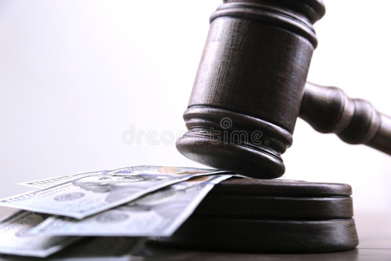 Judge`s gavel, bills of american dollars as concept business, finance corruption, cash deposit. stock photography