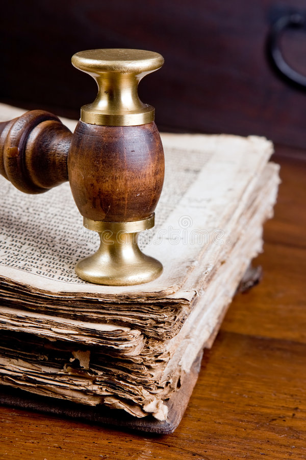 Judge's gavel on book stock photography