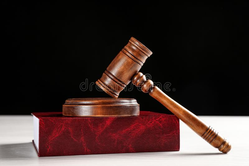 Judge`s gavel and book on white table. Criminal law concept stock photography