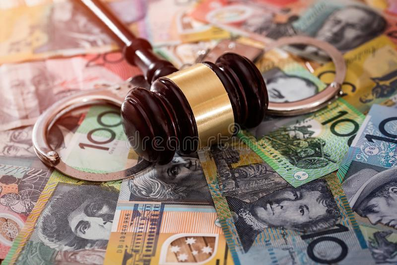 Judge`s gavel with handcuffs on australian dollars.  stock images