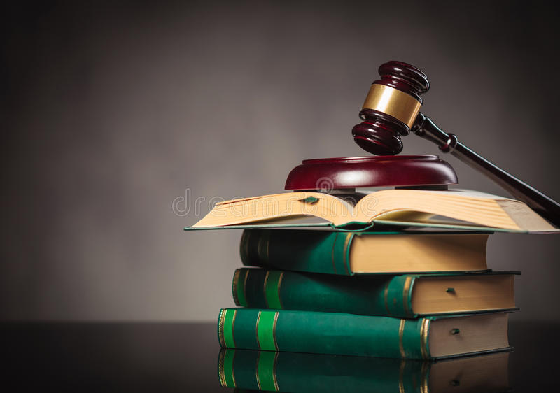 Judge's gavel on a pile of books stock photo