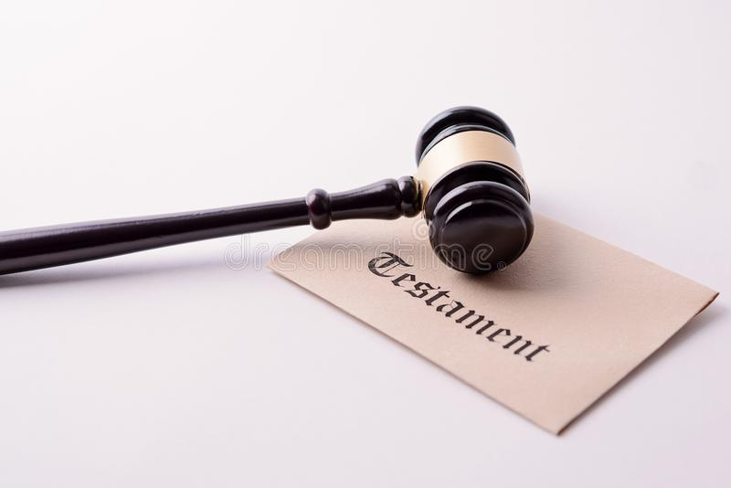 Judge's gavel - the symbol of law on testament royalty free stock photography