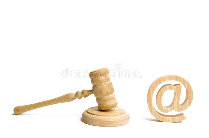 Judge`s hammer and email address. The concept of legal proceedings for the seizure of rights to use the names of mail and website. S. Confiscation of domain stock image