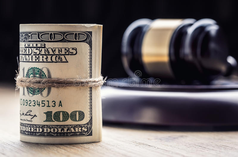 Judge`s hammer gavel. Justice dollars banknotes and usa flag in the background. Court gavel and rolled banknotes. Still life of a bribery, corruption in the US stock photos