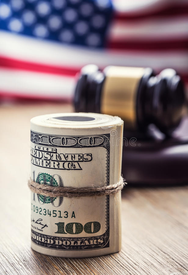 Judge`s hammer gavel. Justice dollars banknotes and usa flag in the background. Court gavel and rolled banknotes. Still life of a bribery, corruption in the US royalty free stock photos