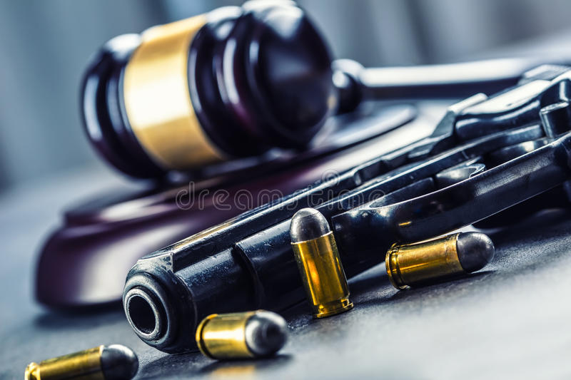 Judge's hammer gavel. Justice and gun. Justice and the judiciary in the unlawful use of of weapons. Judgment in murder.  royalty free stock images