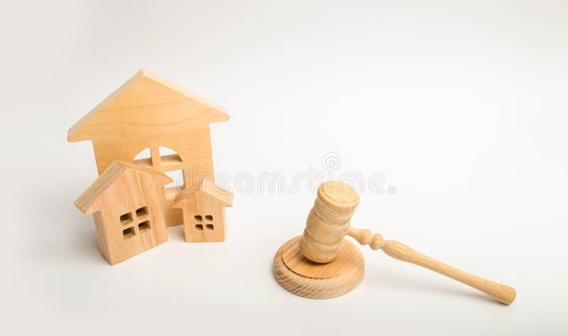 Judge`s hammer and wooden houses. Local government, self-government in a city or township. Decentralization, reservation. Adminis. Trative District, Region royalty free stock image