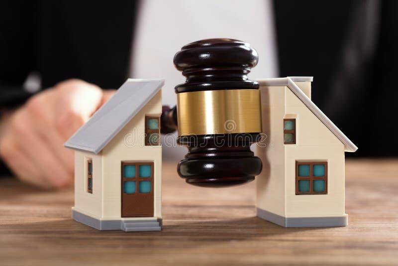 Judge Striking Gavel Between Split House stock photos