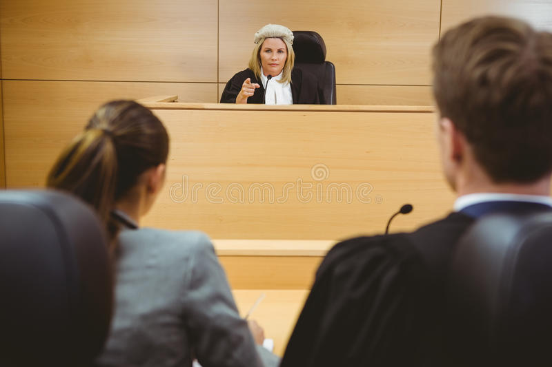 Judge talking with lawyers to make a decision. In the court room stock photos