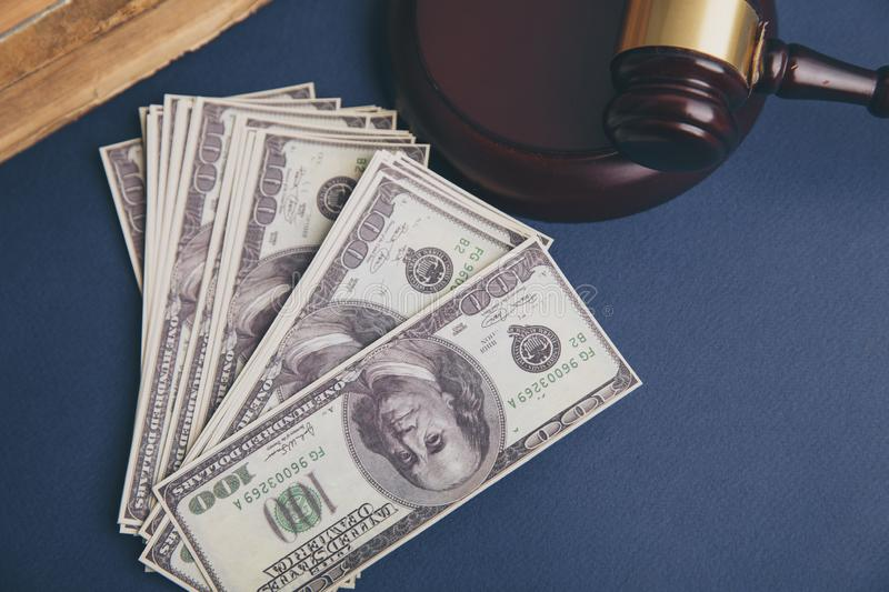 Judge wooden gavel with dollar money banknote concept for royalty free stock photo