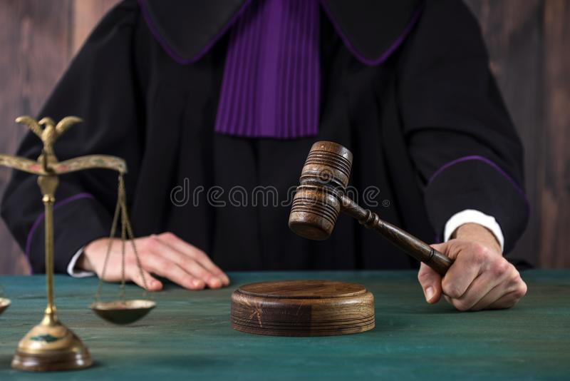 Judge with a wooden judge`s gavel. Supreme Court. Judges gown stock photo