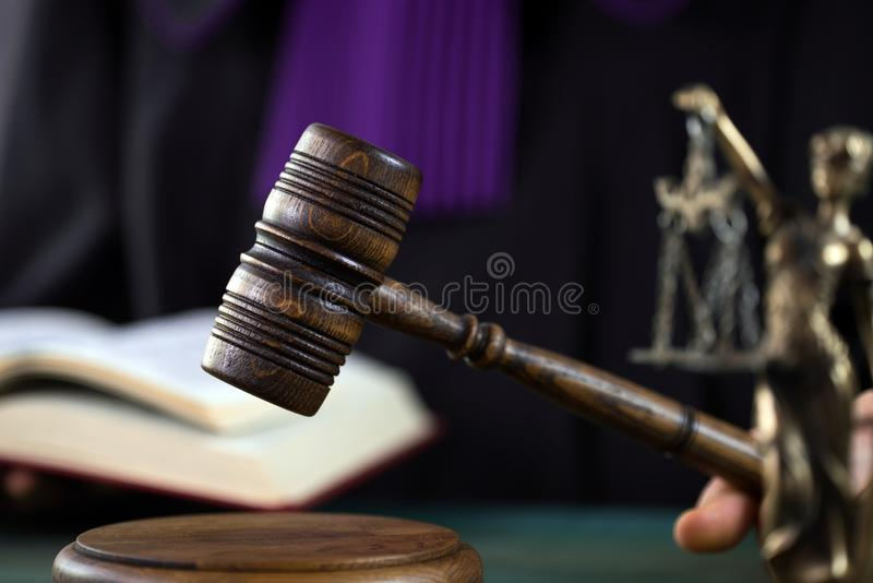 Judge with a wooden judge`s gavel. Supreme Court. Judges gown royalty free stock photography