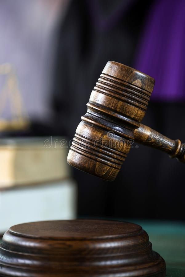 Judge with a wooden judge`s gavel. Supreme Court. Judges gown stock image