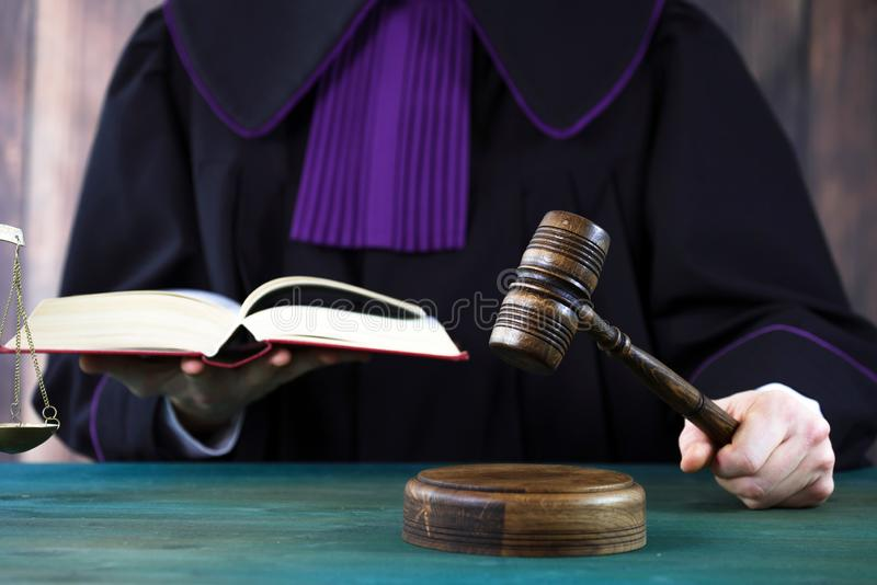 Judge with a wooden judge`s gavel. Supreme Court. Judges gown stock photos