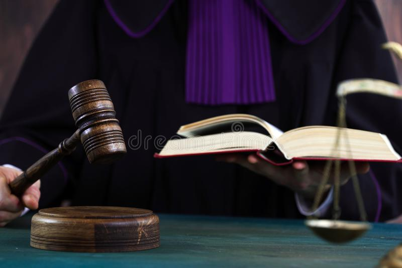 Judge with a wooden judge`s gavel. Supreme Court. Judges gown royalty free stock image