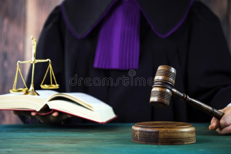Judge with a wooden judge`s gavel. Supreme Court. Judges gown royalty free stock photos